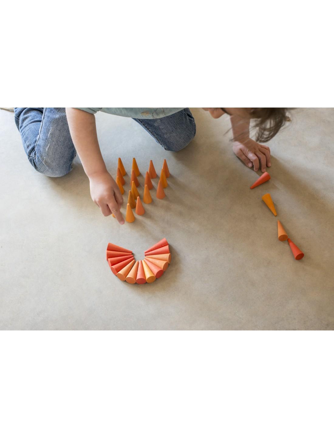 Mandala pequeños conos naranjas. Grapat
